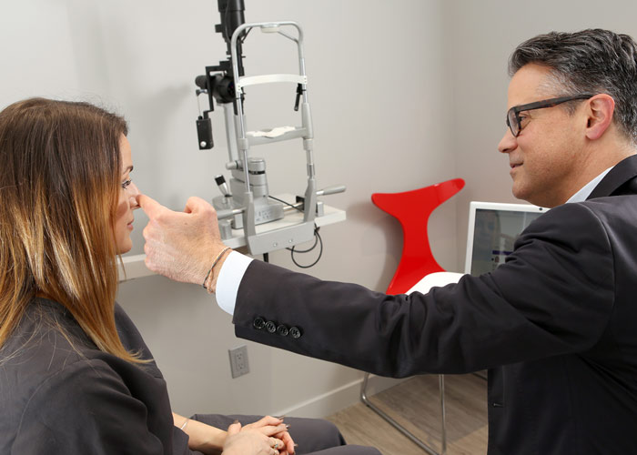 Dr. Sierra providing eyelid surgery consultation