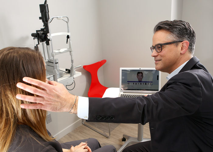 Dr. Sierra showing eyelid to patient